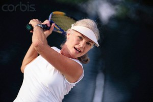 Middle-Aged Woman Playing Tennis