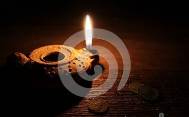 middle-east-oil-lamp-old-coins-burning-clay-wooden-table-55276983